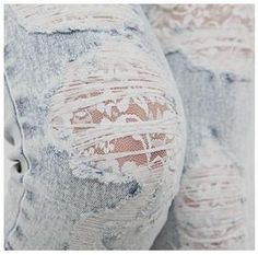 Lace under hole in jeans.