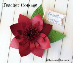 Make your favorite teacher a  Corsage in her favorite color out of paper!  Great idea and can be personalized too.