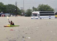 A man rows past a bus partly submerged in flood water in Rishikesh, in the northern Indian state of Uttarakhand, India, Tuesday, June 18, 2013. Monsoon torrential rains have cause havoc in northern India leading to flash floods, cloudbursts and landslides as the death toll continues to climb and more than 1,000 pilgrims bound for Himalayan shrines remain stranded. (Photo by AP Photo) http://avaxnews.me/fact/Heavy_Rain_Showers_in_India.html