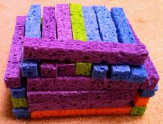 Sponge Blocks - I would cut them into a variety of shapes. These make great travel blocks because they are quiet, light, compact and have some texture to them to reduce sliding around in cars and other moving vehicles.