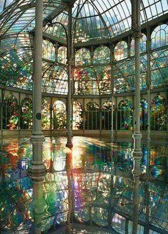 Palacio de Cristal (Crystal Palace), Madrid, Spain. Built in 1887, the architect Ricardo Velazquez.  Artist Kimsooja, To Breathe – A Mirror Woman