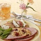 Glazed Ham with Dried Cherry Caramelized Onions - Cooked, boneless ham is glazed with a mixture of honey, mustard and cider vinegar. Serve with sugar snap peas and roasted new potatoes.
