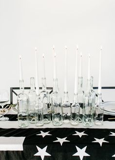 black and white American flag tablecloth with clear bottle candlestick holders - photo by Jessica Lynne Photography