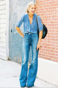 Denim on denim done right with a chambray button up tucked into flare cut jeans