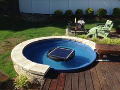 """My small """"poly stock tank"""" mini inground pool with """"natural current"""" solar filter"""