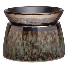Smooth, cool marble tones gleam in a patina of bronze and green. Distinctive metallic glaze creates a highly reflective finish that varies with its surroundings.