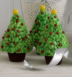 Rice Krispies Christmas Trees.  The link is crappy but here's the gist of it: Reese's Miniatures unwrapped, classic rice krispy treat recipe dyed green & shaped into trees, red sprinkles, and yellow M&M's!