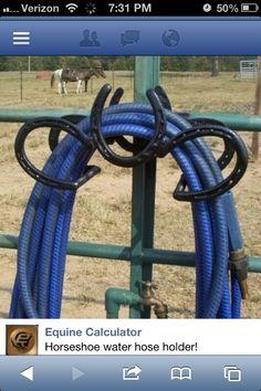 Horseshoe hose hanger