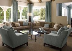 living room colors for Neilsville Soothing cocoa brown & aqua blue color scheme unifies living & dining areas. Note the same drapes used in living room w/ light brown walls & dining room w/ lighter blue walls Brown Carpet Living Room, Brown And Blue Living Room, Beige Living Rooms, Living Room Color Schemes, Living Room Colors, Living Room Sets, Living Room Decor, Living Spaces, Dining Room
