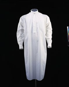 1874 Nightshirt  Place: Britain  Nightshirts changed very little in shape and style throughout the 19th century. They had a plain turned-down collar and were buttoned at the neck, and the centre opening extended a long way down the front. They usually had slits up the side, often reinforced with gussets, to facilitate ease of movement. They were made of cotton, lawn or linen.