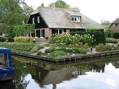 Giethoorn, Holland has no roads, only waterways, bike paths and walking paths... and beautiful homes.