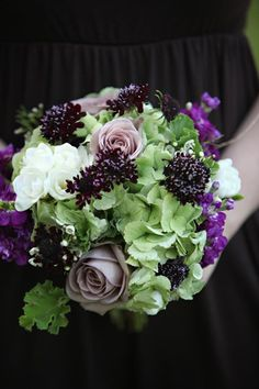 Bouquet composed of antique green hydrangea, eggplant scabiosa, amnesia roses and white freesia