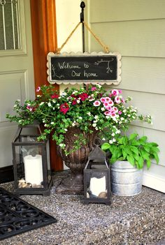 Chalkboard welcome sign hung from a stake inserted into planter urn