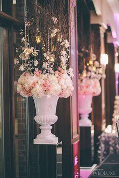Romantic pink and cream blossom urn arrangements -Rania + Kia | WedLuxe Magazine