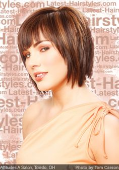 Almost-medium length but still short, shaggy layered cut with bangs. Perfect for rounder face shapes or heart shaped faces.
