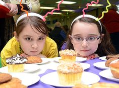 Lily, 9, and Sidney Bacon, 7, have their hearts set on cupcakes at ShroveFest, a pre-Lenten gathering at Messiah Lutheran Church in Fairview...