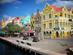 Curacao. Been there, the colors are as vibrant as this photo. Just breath taking  as you cruise in he harbor:)