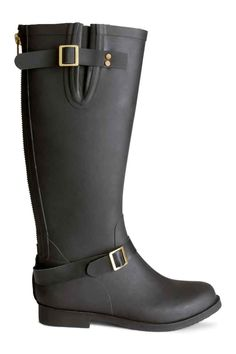5294dc43068 Knee-high rubber boots with a back zip and adjustable straps with metal  buckles.
