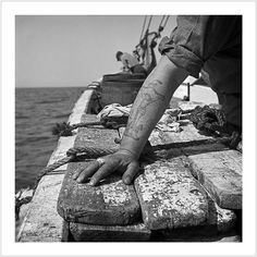 The tattoed arm of a fisherman. On board the fishing boat Alden out of Gloucester, Massachusetts. (1943)