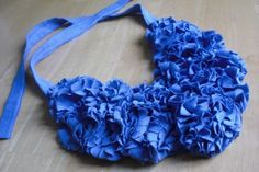 There's plenty of cheap t-shirts you can find at the dollar store, and if you find one in a color you love, you can consider making this flowery bib necklace out of the T.   Source: Dollar Store Crafts