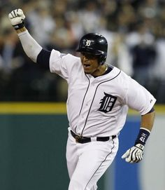 Detroit Tigers Victor Martinez celebrates his home run as he circles the bases.
