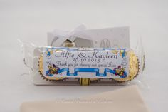 Wedding Photographer - Candid Photos of a Lifetime  Ferrero Rocher with a personalised sticker makes a very yummy wedding favour / bonbonniere