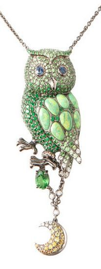 This one of a kind necklace by Wendy Yue features an owl pendant encrusted with green garnet stones and colored diamonds with green turquoise detailing on the wings accompanied by a dangling moon charm surrounded by yellow sapphires set in 18k white gold.