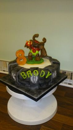 Tree rex skylander cake - making him out of renshaws modelling paste was just a little tricky!