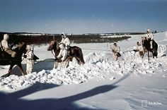 Soldiers on horses in Winter – Continuation War, 1942 – Finnish Defence Forces colour picture of WWII