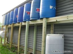 Useful rain barrel system we can hide behind the garage