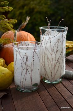 Set of two glass candle holders with felted coating using parts of plants