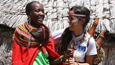 A Turkana woman dresses a humanitarian worker with her creative adorments, backpacks and water / milk bottles which they sell. 2012 © European Union – ECHO/Malini Morzaria
