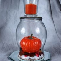 """AUTUMN LEAVES Autumn leaves have fallen in our set of wine glass centerpiece with an orange candle or our hurricane centerpiece. that comes with a orange votive candle.  Both sit upon a on a 5"""" octagon table mirror.  Under the dorm you will find autumn leaves, pumpkins, and acorns. The glasses a..."""