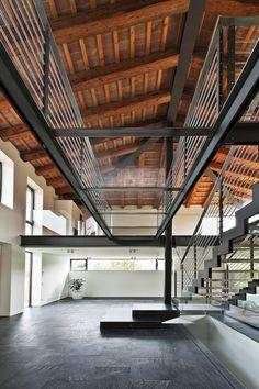 Industrial metal and glass catwalk, renovated farm house in northern Italy, Caprioglio Associati Studio di Architettura