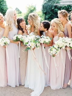 This is one smiley bridal party complete with mix-and-match long dresses: http://www.stylemepretty.com/texas-weddings/austin/2016/08/04/organic-spring-wedding-in-texas/   Photography: Jen Dillender - http://jendillenderphotography.com/
