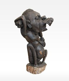 African Wood Sculpture for sale from Tanzanian Fine Art. Devil With Teeth sculpture is intricately carved by African Master Carvers in Tanzania.