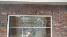 Brick artwork above each window on exterior walls