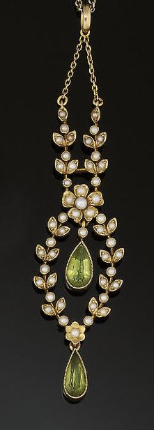 An Edwardian peridot and half-pearl necklace composed of a half-pearl garland pendant with two central collet-set pear-shaped peridot drops to a half-pearl foliate surmount and trace-link neckchain, circa 1900
