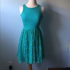 (A51) Teal Lace Dress Bright and happy lace dress in great condition. Only flaw is a hole by the zipper as shown, should be able to be fixed with a few stitches. Fully lined. ♡Please ask any questions! ♡Measurements and modeling available.  ♡Smoke free, pet friendly home.  ♡Please use the offer button to make offers! ♡NO TRADES! Dresses Mini