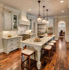 Beautiful hardwood flooring in this great country styled kitchen.