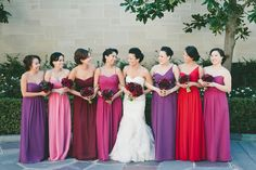 Red, pink and purple jewel tones: http://www.stylemepretty.com//2015/07/27/mix-n-match-bridesmaids-dresses-youll-love/