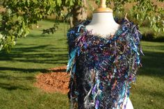 A personal favorite from my Etsy shop https://www.etsy.com/listing/479900125/fringed-poncho-dumpster-diva-cool-jewel