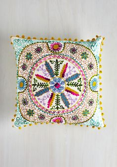 Bo-Homey Pillow. Combining homespun-style embellishments with vintage-inspired design, this needle-pointed white accent pillow by Karma Living bursts with familiar charm! #multi #modcloth