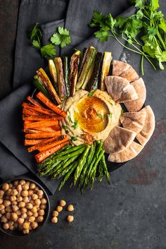 Springtime Hummus Bowl with Roasted Veggies #asparagus #carrots #chickpeas #lemonevoo #pitabread #tahini #zucchini