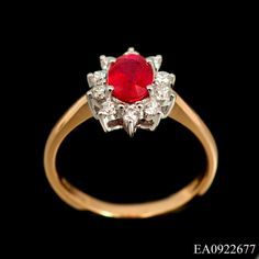 Comprising of a single oval cut ruby (1.04ct) surrounded by 10 x round cut diamonds(.30ct total) this cluster ring is stunning. The stones are claw set on a low mount and the 18ct yellow gold tapered shank compliments the design beautifully. £1675