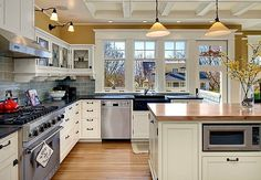 Seattle Kitchen of the Year.   Windows with sink and door.