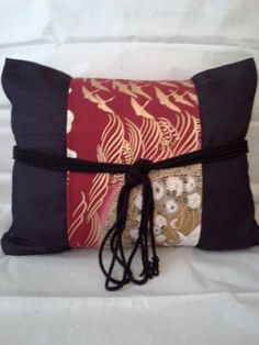 Japanese Obi Sash on Pillows by Carmen716 on Etsy. These lovely pillows were made from gorgeous Asian fabrics. See more Asian quilt fabrics like this at: http://www.debsews2.com/