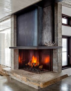 Fireplace hearth in Modern Mountain Home Home Fireplace, Living Room With Fireplace, Fireplace Surrounds, Fireplace Design, Fireplace Ideas, Fireplace Hearth, Black Fireplace, Small Fireplace, Fireplace Inserts