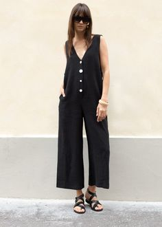 """Sleeveless Jumpsuit w/Wide, Cropped Leg. White Button Front Closure. 2 Side Pockets. Relaxed Fit Linen Blend 23"""" Inseam Length, 40"""" Bust, 32.5"""" Rise Dry Clean Imported"""