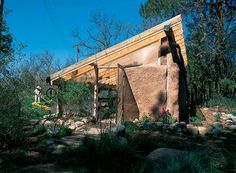 Strawbale construction makes a novice builder's greenhouse affordable, eco-friendly, and easy. Greenhouse Plans, Greenhouse Gardening, Biointensive Gardening, Straw Bale Construction, Le Ranch, Mirror Wall Clock, Farm Projects, Straw Bales, Thing 1